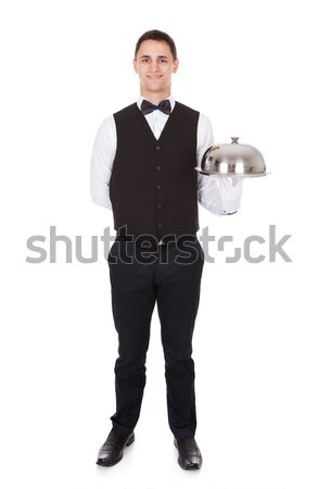 Portrait Of Confident Waiter Tray With Cloche Lid Stock photo © AndreyPopov