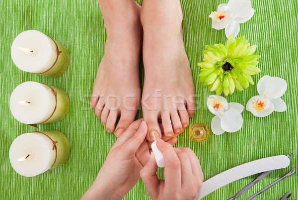 Beautician Applying Nail Varnish To Woman Stock photo © AndreyPopov