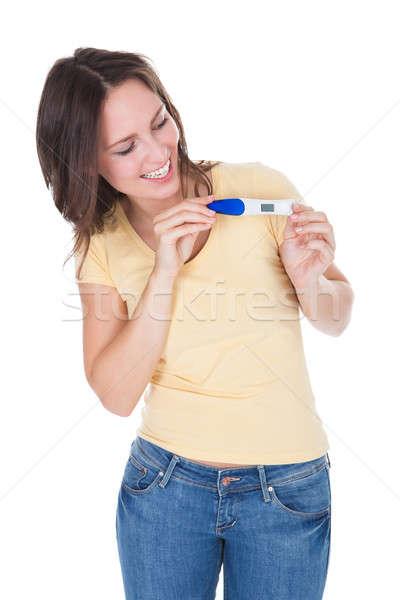 Happy Woman Looking At Pregnancy Result Stock photo © AndreyPopov