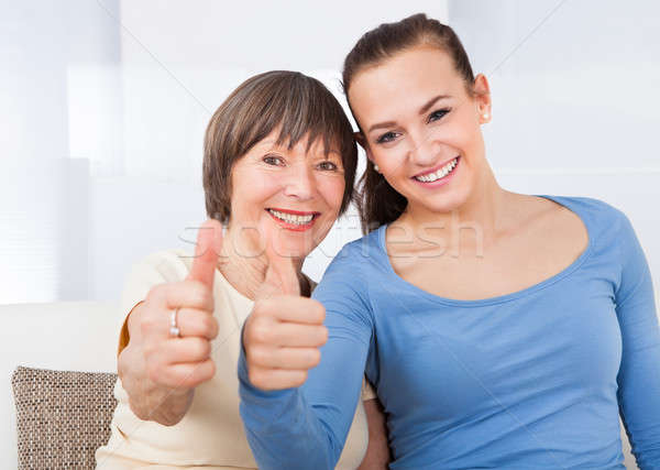 Caregiver And Senior Woman Showing Thumbs Up Stock photo © AndreyPopov