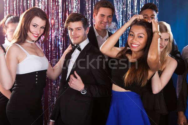 Friends Dancing At Nightclub Stock photo © AndreyPopov