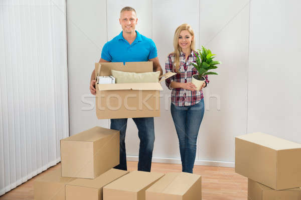 Young Couple Moving Boxes In New Home Stock photo © AndreyPopov