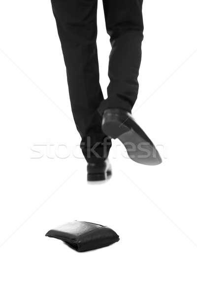 Businessman Walking Against Fallen Wallet Stock photo © AndreyPopov