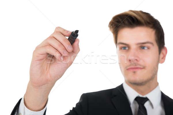 Businessman Writing On Transparent Screen Stock photo © AndreyPopov
