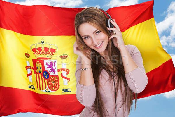 Femme écouter espagnol apprentissage musique casque Photo stock © AndreyPopov