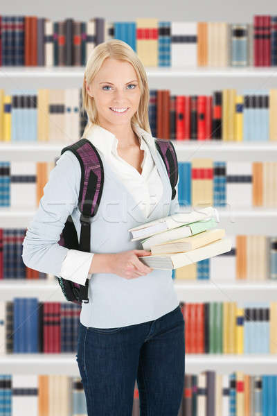 Young College Student Girl In A Library Stock photo © AndreyPopov