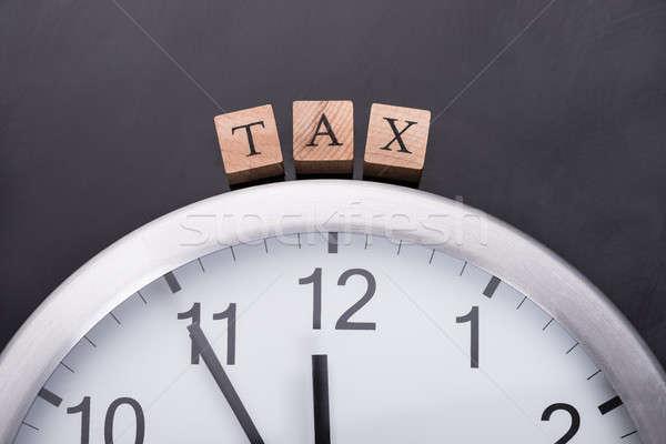 Relógio imposto tempo preto financeiro Foto stock © AndreyPopov