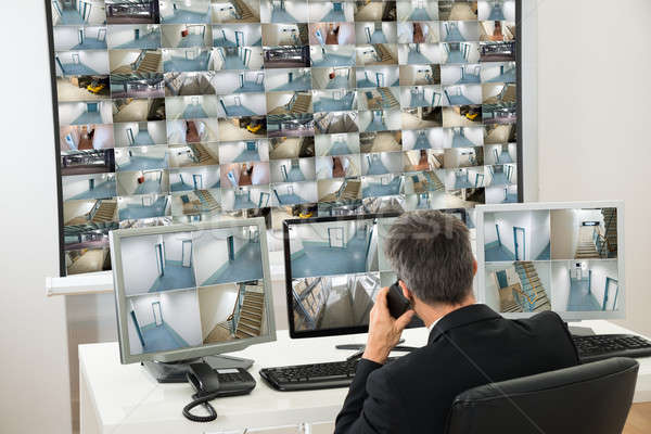 Security System Operator Looking At Cctv Footage Stock photo © AndreyPopov