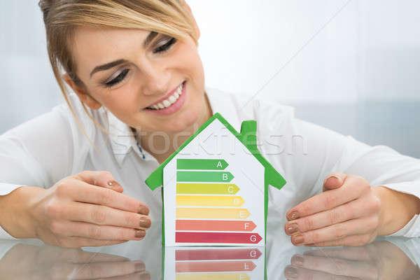 Femme d'affaires énergie efficace graphique maison modèle Photo stock © AndreyPopov