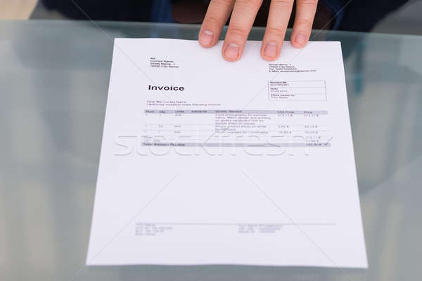 Person's Hand With Invoice Stock photo © AndreyPopov
