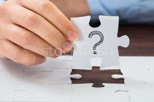 Person Hand Holding Puzzle With Question Mark Stock photo © AndreyPopov