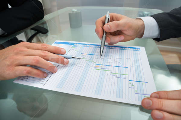 Two Businessmen Making Gantt Diagram Stock photo © AndreyPopov