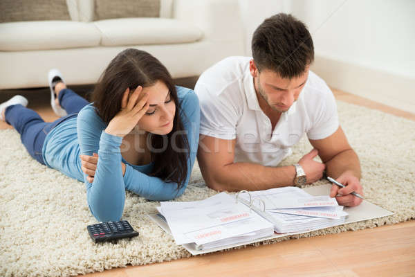 Worried Young Couple Calculating Their Bills At Home Stock photo © AndreyPopov