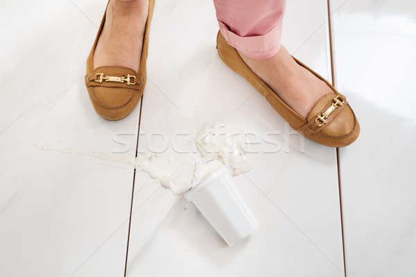 Female Leg With The Spilled Yoghurt Stock photo © AndreyPopov