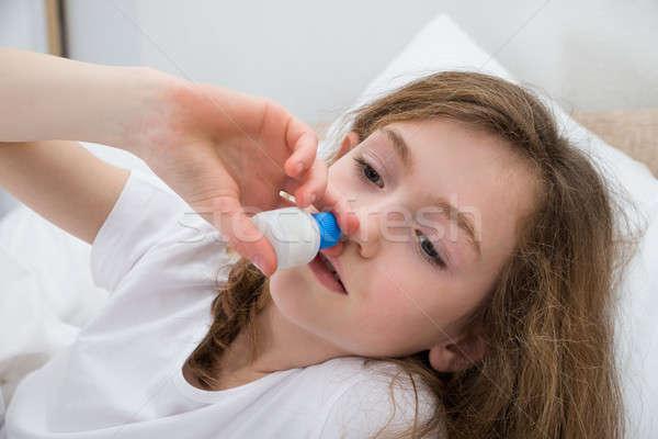Ragazza spray primo piano malati camera da letto bambino Foto d'archivio © AndreyPopov