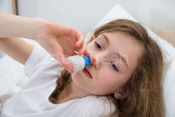 Girl Using Nasal Spray Stock photo © AndreyPopov