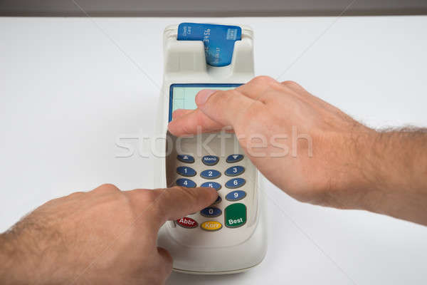 Stock photo: Person Hand Entering Code In A Card Reader