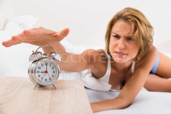 Woman Turning Off The Alarm Clock Stock photo © AndreyPopov