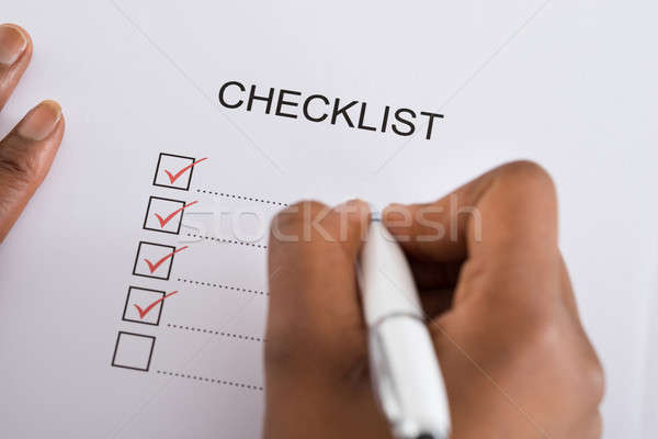 Stock photo: Person's Hand Marking Check Box With Red Pen