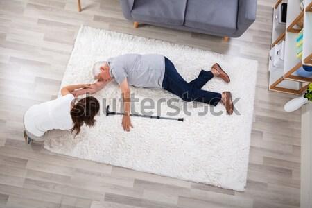 Nő gyomorfájás kanapé magasról fotózva kilátás fiatal Stock fotó © AndreyPopov