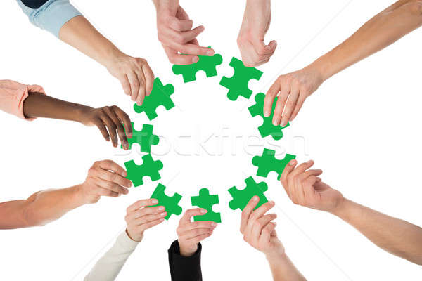 Stock photo: Creative Business People Holding Green Jigsaw Pieces
