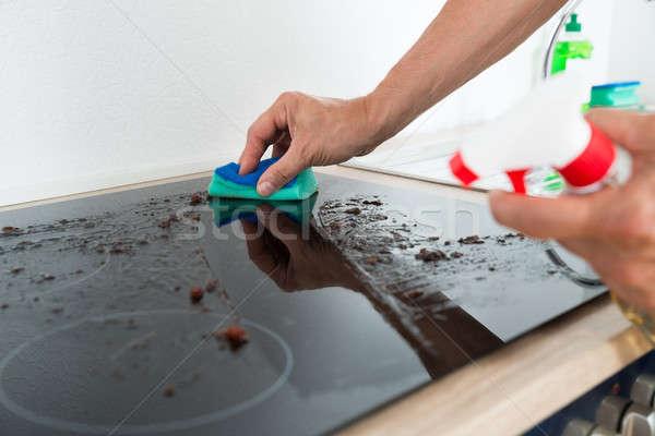 Limpieza estufa imagen masculina mano Foto stock © AndreyPopov