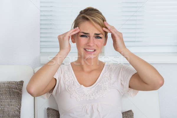 Stock photo: Portrait Of Woman Suffering From Headache