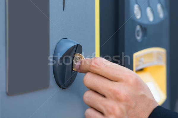 Person's Hand Inserting Coin At Parking Meter Stock photo © AndreyPopov
