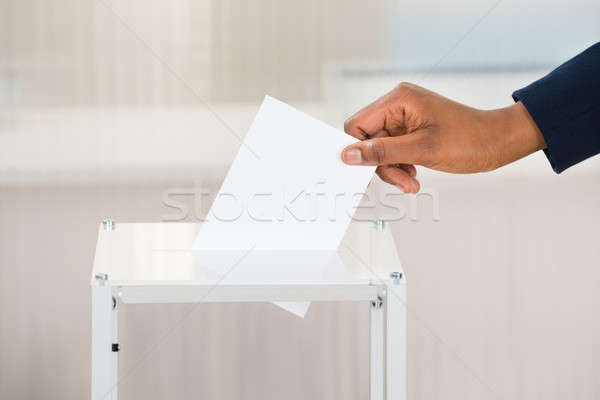 Person's Hand Putting Ballot In Box Stock photo © AndreyPopov