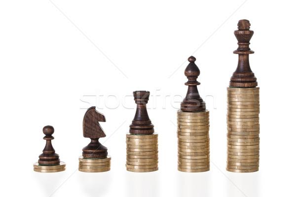 Piezas de ajedrez monedas blanco fondo juego Foto stock © AndreyPopov