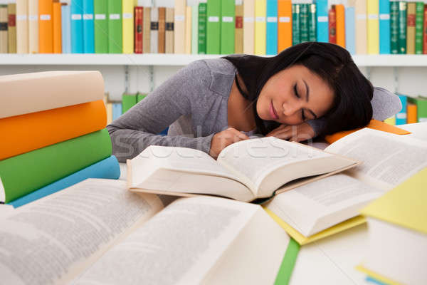 Female Student Sleeping On Books In Library Stock photo © AndreyPopov