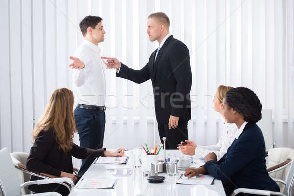 Businessman Blaming His Colleague In Meeting Stock photo © AndreyPopov