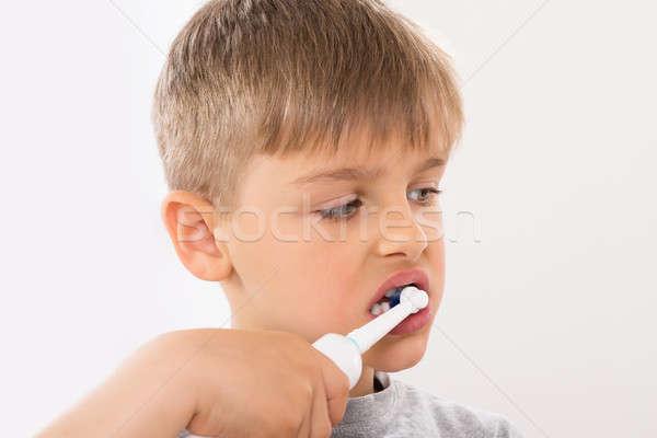 мальчика электрических зубная щетка медицинской Сток-фото © AndreyPopov