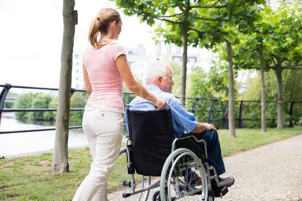 Gülen genç kadın özürlü baba tekerlekli sandalye yandan görünüş Stok fotoğraf © AndreyPopov