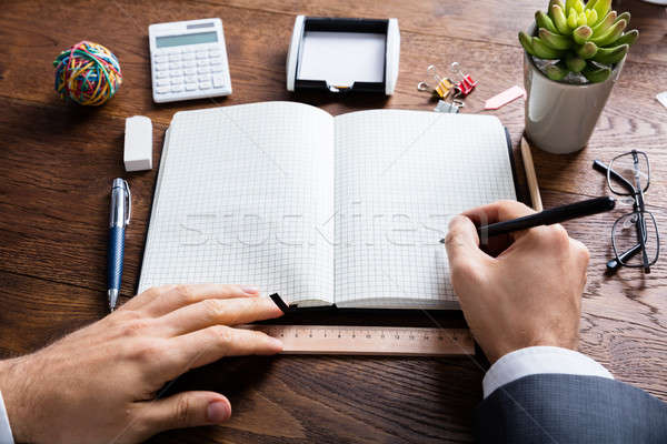 Businessperson Holding Pen On Diary Stock photo © AndreyPopov