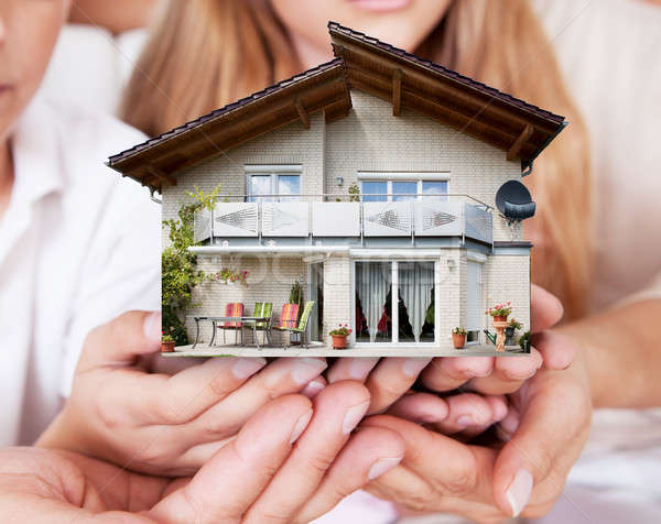 Family Holding The House Model Together Stock photo © AndreyPopov