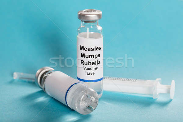 Measles Mumps Rubella Vaccine Vials With Syringe Stock photo © AndreyPopov