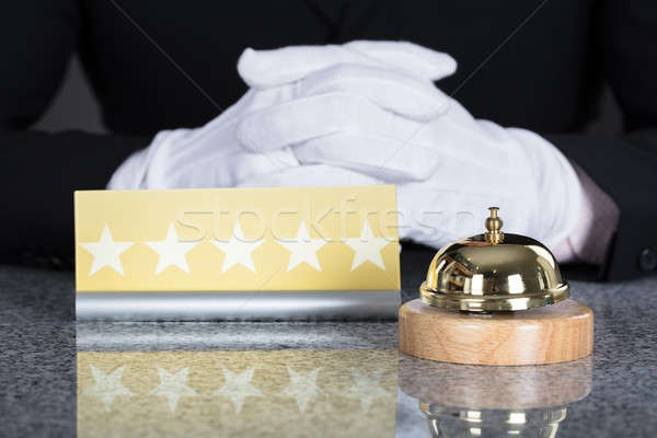 Waiter Near Service Bell And Five Star Shape Card Stock photo © AndreyPopov