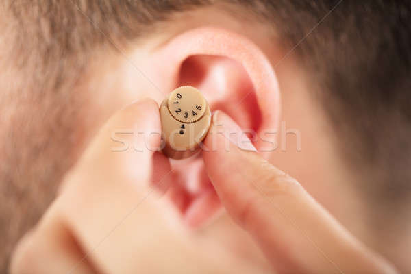 Person With A Hearing Aid Stock photo © AndreyPopov