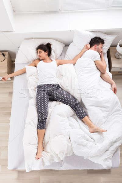 Young Woman Sleeping Beside Her Husband Stock photo © AndreyPopov
