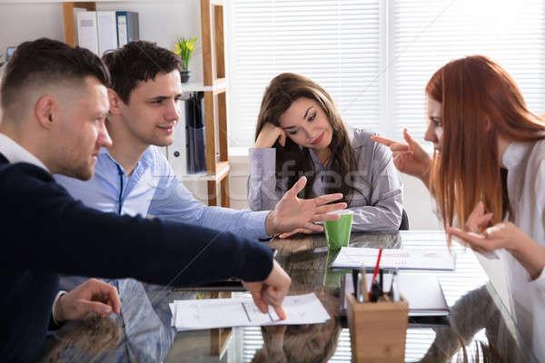 Zakenlieden ruzie vergadering zakenvrouw zakelijke bijeenkomst Stockfoto © AndreyPopov