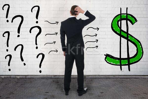 Verwechselt Geschäftsmann schauen Fragezeichen Dollarzeichen Rückansicht Stock foto © AndreyPopov