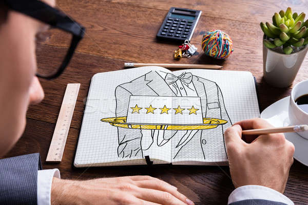 Five Star Hospitality Service In Notepad Stock photo © AndreyPopov
