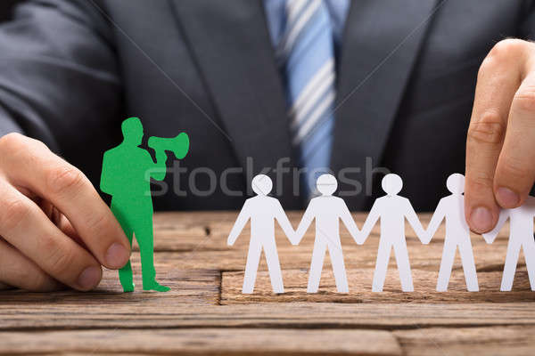 Holding Green Paperman Speaking Through Megaphone With Team Stock photo © AndreyPopov