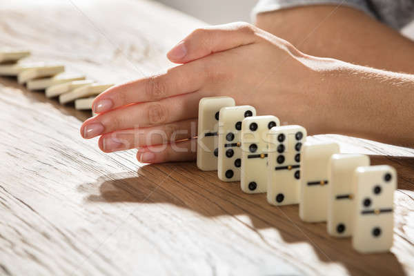 Businesswoman Supports Domino From Falling Stock photo © AndreyPopov
