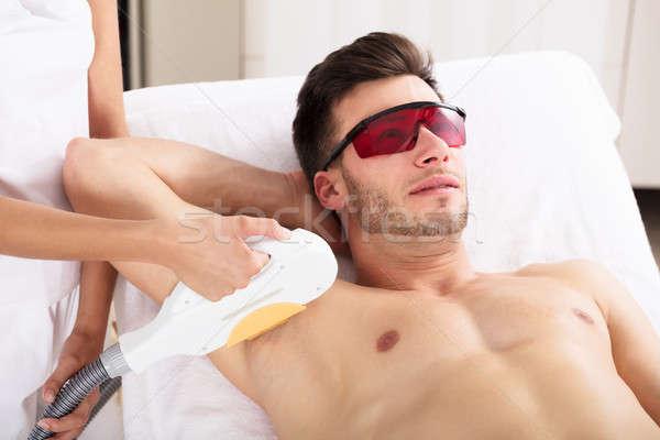 Man Having Underarm Laser Hair Removal Treatment Stock photo © AndreyPopov