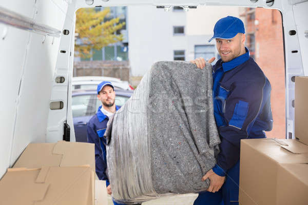 Two Movers Unloading Furniture From Truck Stock photo © AndreyPopov