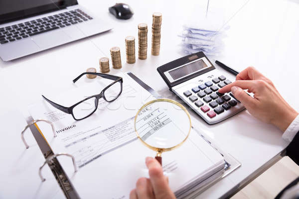 Businesswoman Checking Invoice With Magnifying Glass Stock photo © AndreyPopov