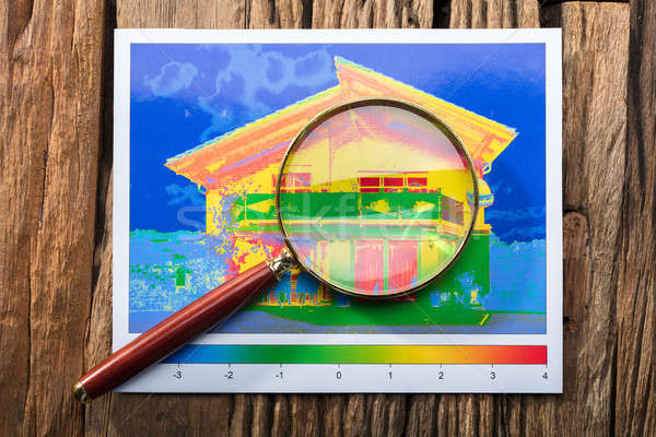 Magnifying Glass On Heat Loss Efficiency Of A House Stock photo © AndreyPopov