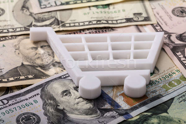 Bevásárlókocsi dollár bankjegyek közelkép fehér vásárlás Stock fotó © AndreyPopov